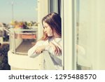 teenage girl looking out the... | Shutterstock . vector #1295488570