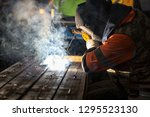 the welder is welding with... | Shutterstock . vector #1295523130