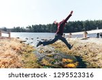 Boy Jumping Over A Stream....