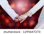 holding hands loving couple... | Shutterstock . vector #1295647273
