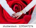 holding hands loving couple... | Shutterstock . vector #1295647276