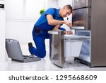 mature male serviceman... | Shutterstock . vector #1295668609