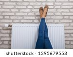 close up of a woman warming up... | Shutterstock . vector #1295679553