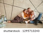 happy parents with their... | Shutterstock . vector #1295713243