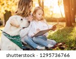 happy beautiful mother and... | Shutterstock . vector #1295736766