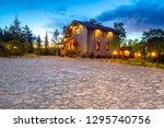 two houses. cottage surrounded... | Shutterstock . vector #1295740756