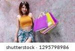 attractive joyful excited young ... | Shutterstock . vector #1295798986
