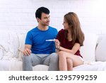 happy young couple smiling... | Shutterstock . vector #1295799259
