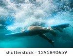 surfer underwater underwater... | Shutterstock . vector #1295840659