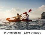 happy coulple walks by sea... | Shutterstock . vector #1295890099