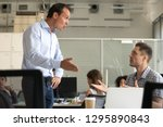 angry millennial colleagues... | Shutterstock . vector #1295890843