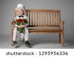 happy little boy in a suit on a ... | Shutterstock . vector #1295956336
