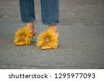 Small photo of Copenhagen,Denmark-August 11 2018: Tine Andrea in exclusive mustard yellow Tory Burch shoes outside Ganni show during Copenhagen fashion week Spring/Summer 2019.
