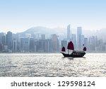 junk boat in hong kong harbor... | Shutterstock . vector #129598124
