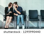 man whispering to a womans ear. ... | Shutterstock . vector #1295990440