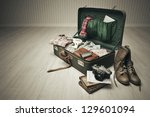 Vintage Suitcase Open On A Woo...