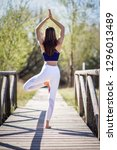 young woman doing yoga in... | Shutterstock . vector #1296013489