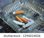 close up  cigarette butts... | Shutterstock . vector #1296014026