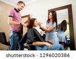 a young woman in a beauty salon ... | Shutterstock . vector #1296020386