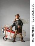 little boy in a pilot's suit... | Shutterstock . vector #1296021130
