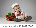 little boy in a sailor suit... | Shutterstock . vector #1296022060