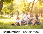 young family with smiles and... | Shutterstock . vector #1296044959