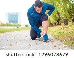 athlete running outdoor and... | Shutterstock . vector #1296078679