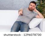 portrait of bored couch potato... | Shutterstock . vector #1296078730
