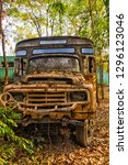 Old Thai School Bus In A Forest