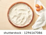 raw egg and flour on wooden... | Shutterstock . vector #1296167086