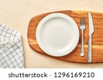 empty plate and chopping board... | Shutterstock . vector #1296169210