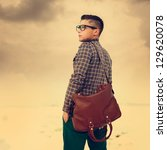 handsome hipster guy with a bag.... | Shutterstock . vector #129620078