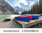 many canoes on wooden deck at... | Shutterstock . vector #1296208810