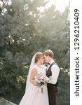 bride and groom posing | Shutterstock . vector #1296210409