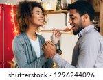 happy couple tasting food in... | Shutterstock . vector #1296244096