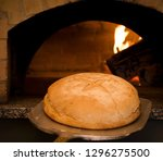 traditional bread cooked in a... | Shutterstock . vector #1296275500