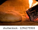 traditional bread cooked in a... | Shutterstock . vector #1296275503