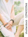 stylish woman dressed in beige... | Shutterstock . vector #1296323566