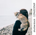 young woman with cat standing... | Shutterstock . vector #1296323569