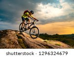 cyclist riding the mountain... | Shutterstock . vector #1296324679