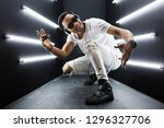 young handsome smiling hipster... | Shutterstock . vector #1296327706
