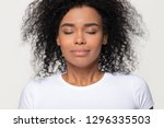 happy calm african woman with... | Shutterstock . vector #1296335503