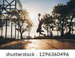 black man doing sports  playing ... | Shutterstock . vector #1296360496