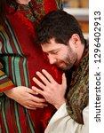 affectionate husband touching... | Shutterstock . vector #1296402913