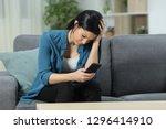sad woman checking smart phone... | Shutterstock . vector #1296414910