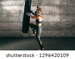 dedicated strong brunette with... | Shutterstock . vector #1296420109