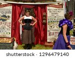 Small photo of Coldwater, Ontario, Canada - August 10, 2013: Sideshow huckster of novelties and magic at Coldwater Canadiana Heritage Museum steampunk festival