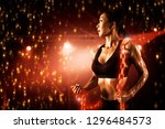 muscular fit woman working with ... | Shutterstock . vector #1296484573