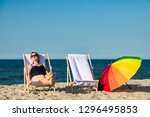 Woman relaxing on beach - stock photo