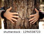 woman hugging tree bark  ... | Shutterstock . vector #1296538723